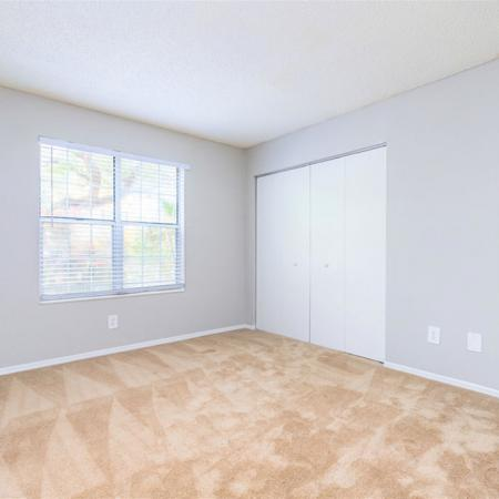 Unfurnished bedroom with ceiling fan and carpeting