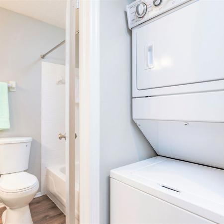 Stacked Washer and dryer looking into bathroom