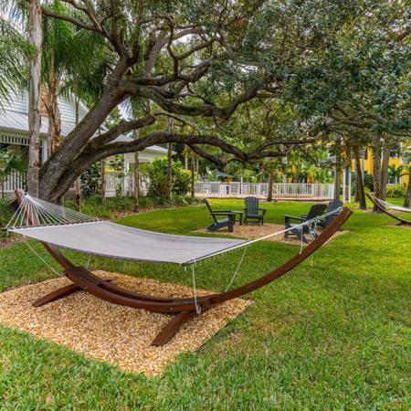 Hammock surrounded by trees and lush landscaping