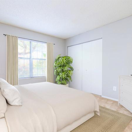 Furnished bedroom with bed and dresser