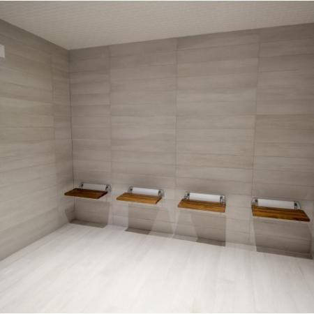Spa room with floor to ceiling tiles and four wall mounted individual wood benches.