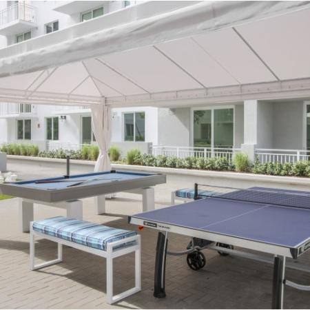 Outdoor over-sized chess set and covered pool and ping pong tables