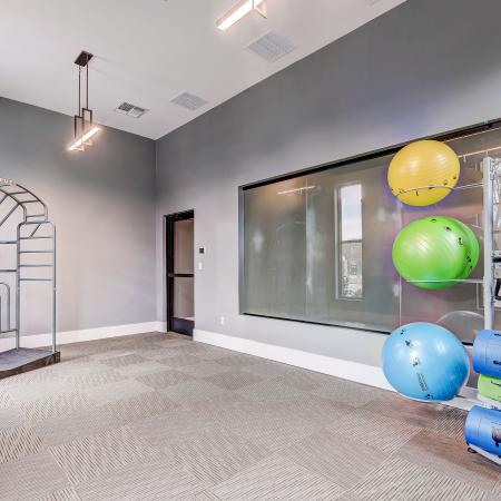 24/7 fitness center. stretching station, yoga balls, yoga mats