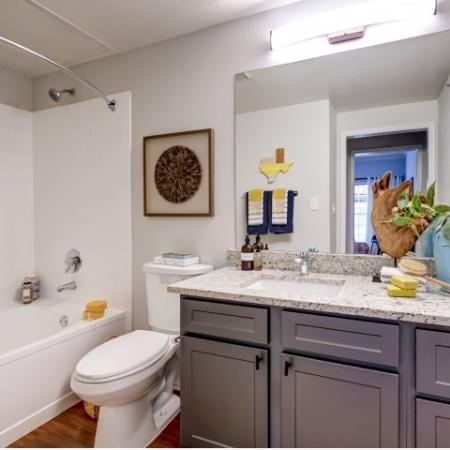 Beautiful bathroom, single sink, granite counter tops, shower tub combination