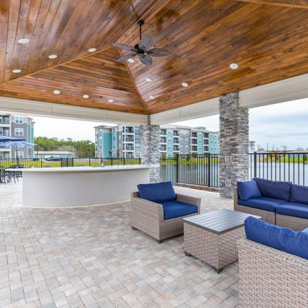 San Mateo Apartments Kissimmee Florida outdoor kitchen with grills and seating area