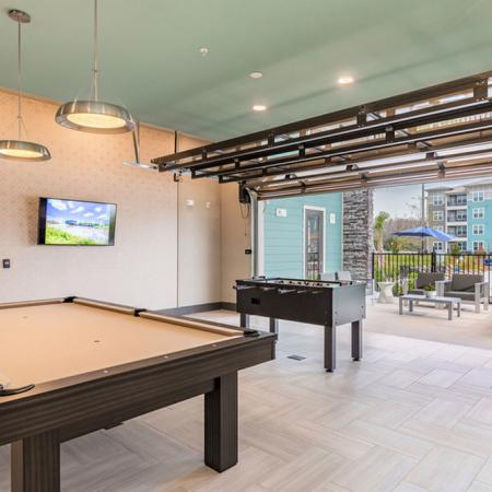 San Mateo Apartments Kissimmee Florida gaming lounge with pool table and foosball table