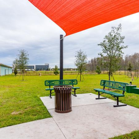 San Mateo Apartments Kissimmee Florida outdoor pet park with agility equipment, benches and water fountain
