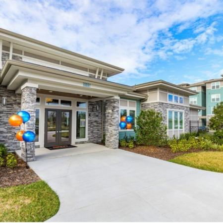 San Mateo Apartments Kissimmee Florida community clubhouse entry way by manicured landscaping