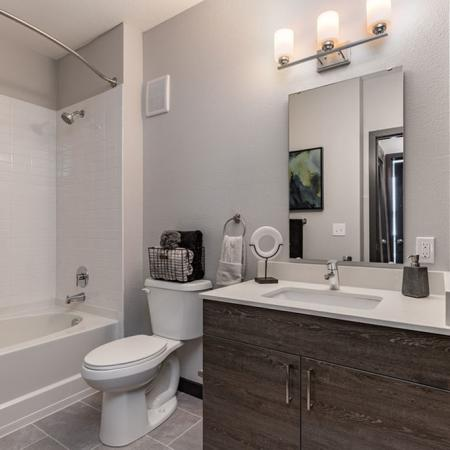 View of furnished model bath with espresso cabinetry
