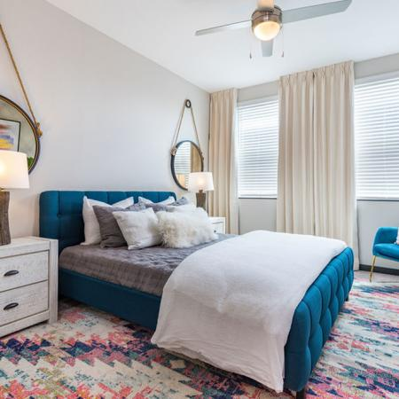 View of furnished bedroom with bed, nightstands and decor