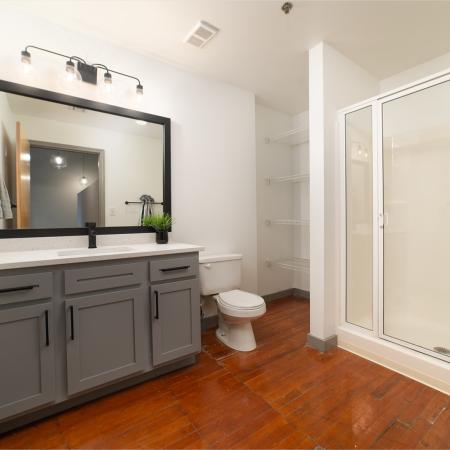 Wide angled shot of newly upgraded bathroom with storage and walk-in shower
