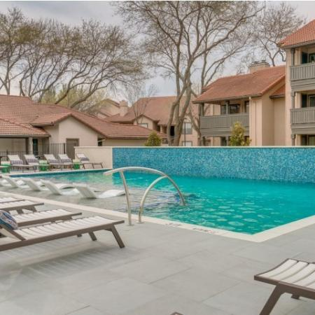 Sparkling swimming pool with lounge seating
