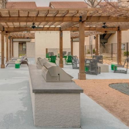 Outdoor courtyard with lounge seating with two gas grills.
