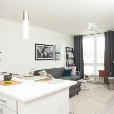 Residents Lounging in the Living Room | Allston Apartments Boston | TRAC 75
