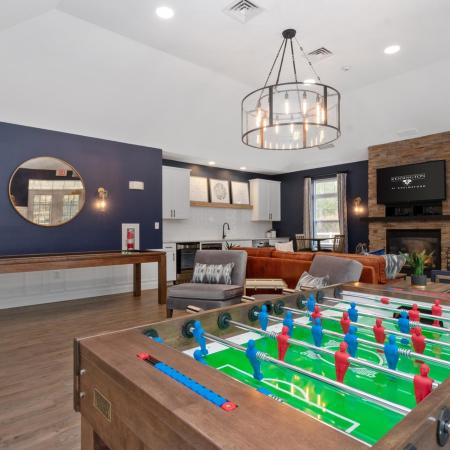 Game tables in clubhouse at Kensington apartments in Chelmsford MA