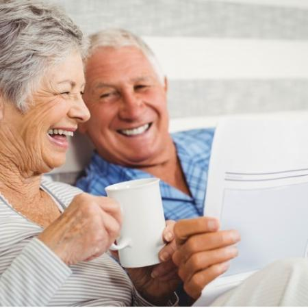 couple having coffee and reading paper