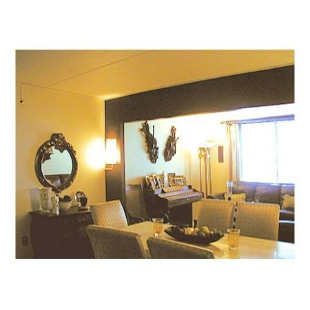 Queenswood Apartments, interior, dining room, living room, large window, sofas, table and chairs, piano