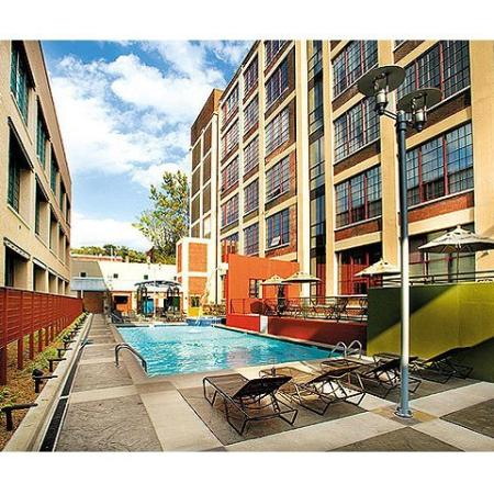 tobacco row river lofts community pool with lounge chairs