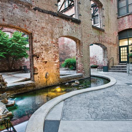 shockoe bottom apartment pond with brick walls