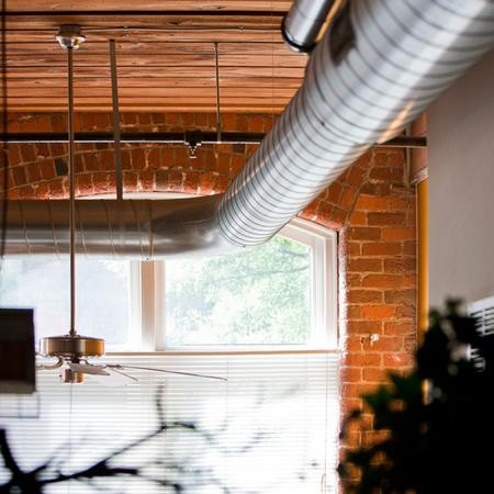 loft exposed brick ductwork and industrial windows