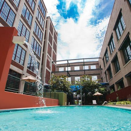 river lofts community pool with water fall