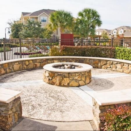 Outdoor fire pit at Lakeland Estates Apartment Homes in Stafford, TX