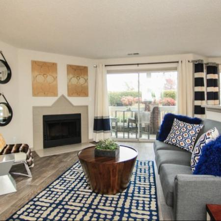 Spacious living areas with wood burning fireplace at Reafield Village Apartments in Charlotte, NC