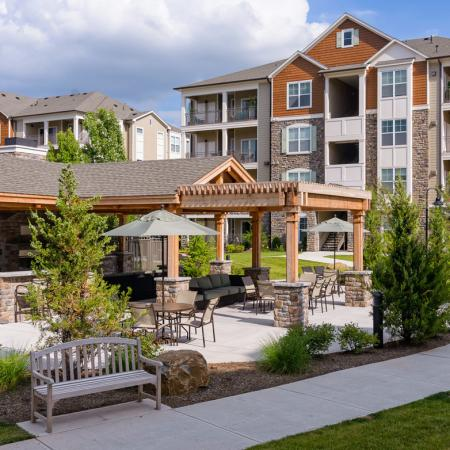 Poolside BBQ grills and picnic areas at Atley on the Greenway in Ashburn, VA