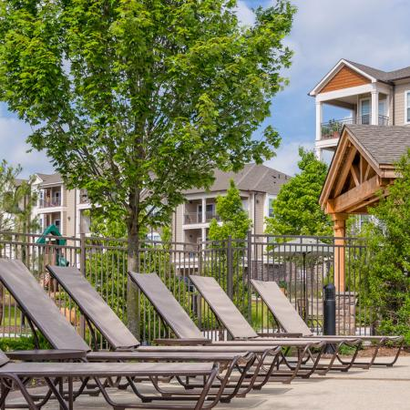 Swimming pool with large sundeck at Atley on the Greenway Apartments in Ashburn, VA