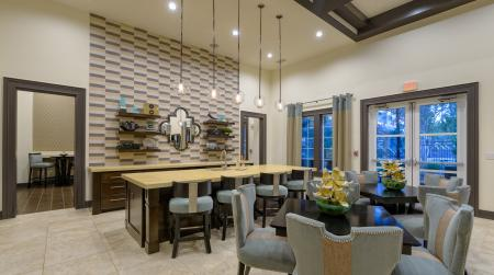 Clubhouse with gourmet presentation kitchen at Atley on the Greenway Apartments in Ashburn, VA