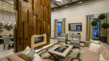 Clubhouse with cozy fireplace at Atley on the Greenway Apartments in Ashburn, VA