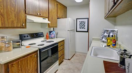 Kitchen with dishwasher at Avery Park Apartments in Fairfield, CA