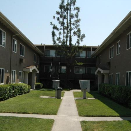 Lush landscaping at Walden Glen Apartments in Buena Park, CA