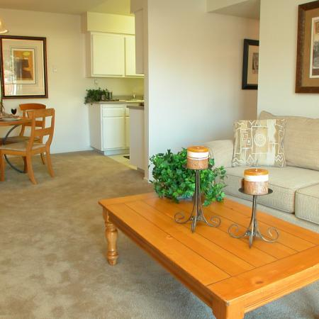 Living and dining area at Timberleaf Apartments in Lakewood, CO