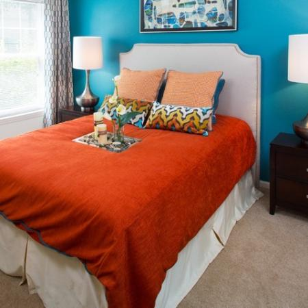 Colorful bedroom at Grand Reserve Orange Apartments in Orange, CT.