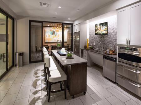 Lounge kitchen area at Terrena Apartment Homes in Northridge, CA