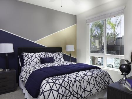 Bedroom with Abstract Accent Wall at Pulse Millenia in Chula Vista, CA