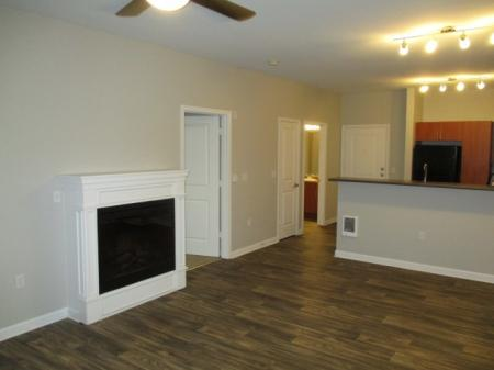 Living room with new flooring at Sanctuary Apartments in Renton WA