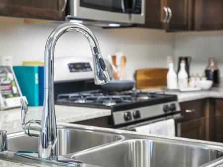 Moen faucet kitchen fixture at Pulse Millenia in Chula Vista, CA