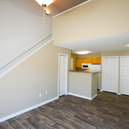 Lofted floorplans with wood look flooring at The Village of Western Reserve Apartments in Streetsboro, OH