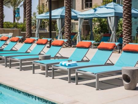 Pool lounge chairs at Pulse Millenia in Chula Vista, CA
