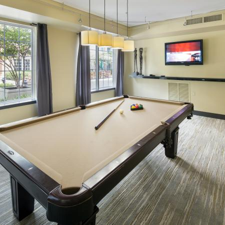 Challenge your friends to a game of pool with our billiards table at Dwell Vienna Metro