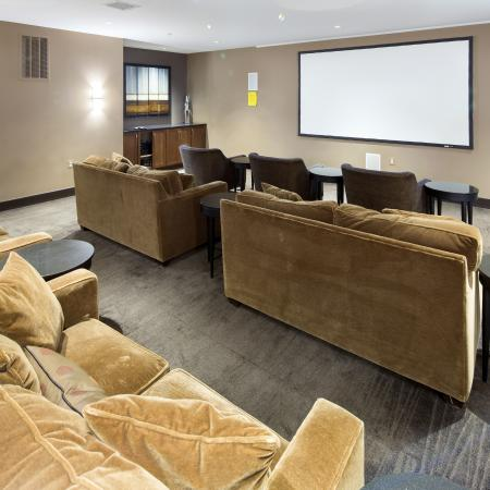 Media room with a 120 projection screen and surround sound at Dwell Vienna Metro Apartments in Fairfax, VA