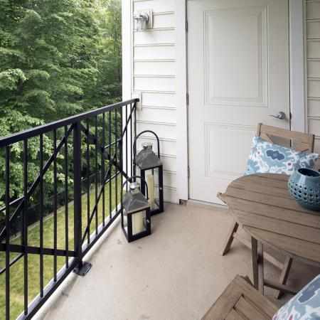 Get a breath of fresh air and relax outside in your own private patio at Dwell Vienna Metro Apartments in Fairfax, VA