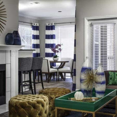 Living Room with Fireplace at The Brixton Apartments in Dallas, TX