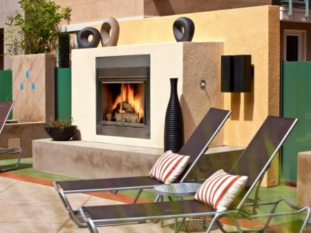 Outdoor fireplace lounge at Alterra at Grossmont Trolley Apartments in La Mesa, CA