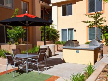 Outdoor picnic area with BBQ grills at Alterra at Grossmont Trolley Apartments in La Mesa, CA