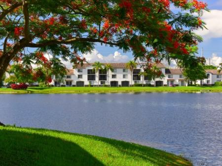 Take an afternoon stroll by the lake at Doral West Apartments