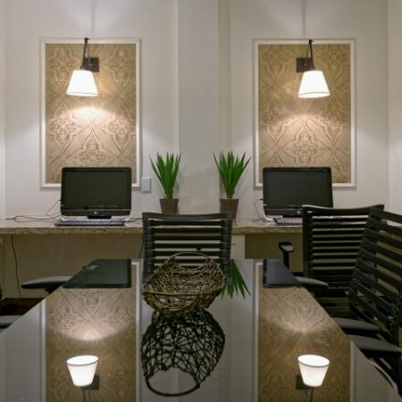 Pop in to the business center to update your facebook at Doral West Apartments