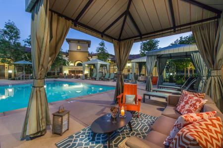 Poolside seating at Capriana at Chino Hills Apartments in Chino Hills CA